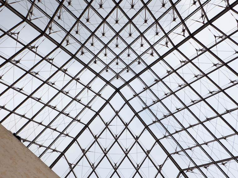 The Louvre Pyramid (Pyramide du Louvre) is a large glass and metal pyramid designed by Chinese-American architect I.M. Pei, surrounded by three smaller pyramids, in the main courtyard (Cour Napoléon) of the Louvre Palace (Palais du Louvre) in Paris.