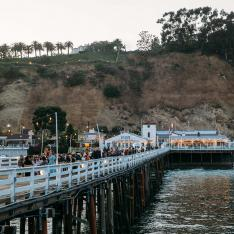 Outstanding in the Field Celebrates Its 20th Anniversary With a Malibu Pier Party & Massive Tour
